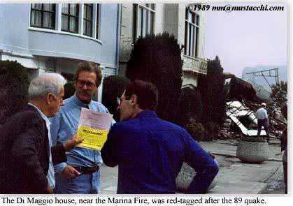 Joe Di Maggio holds No Occupancy posting for his quake-damaged home in the Marina District, near the Marina Fire.