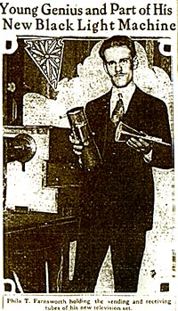 Philo Farnsworth holds sending and receiving tubes for the television system he invented. - San Francisco Chronicle photo.