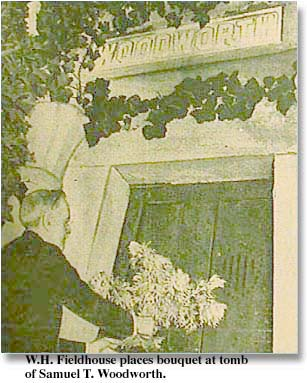 W. H. Fieldhouse places bouquet of flowers at tomb of Samuel T. Woodworth